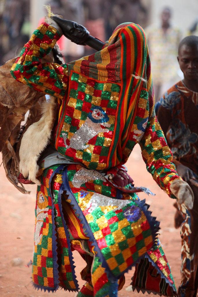 Egungun - African man wearing an elaborate costume