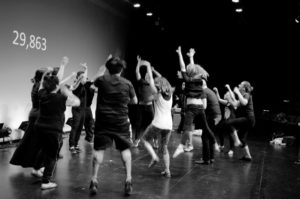black and white photo and students dancing on stage