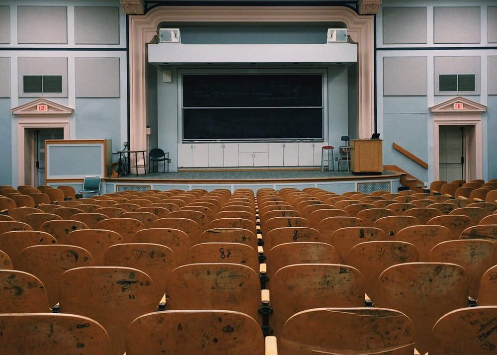 image of an empty lecture hall from the back
